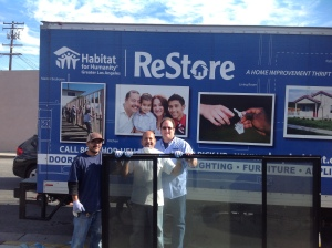 Kenny donating to Habitat for humanity